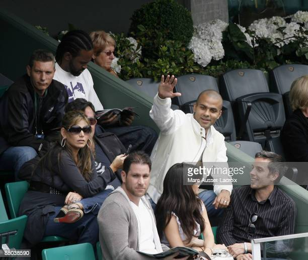 Tony Parker and guests attend the second round match between Switzerland's Roger Federer and Argentina's Jose Acasuso at the French Open tennis...