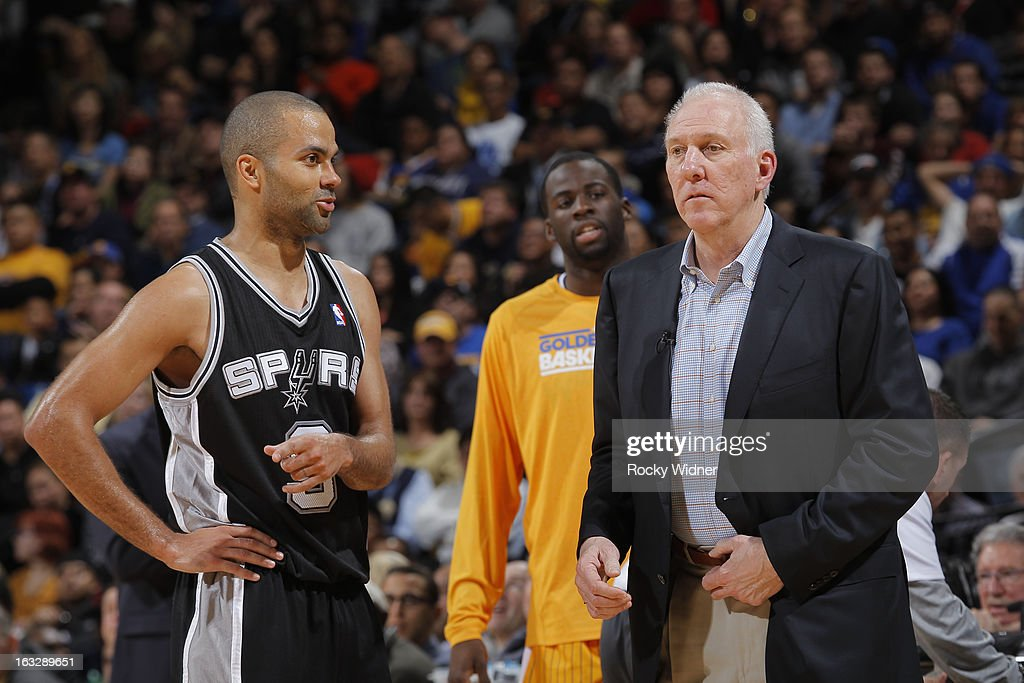 Tony Parker #9 and Head Coach Gregg Popovich of the San Antonio Spurs in a game against the Golden State Warriors on February 22, 2013 at Oracle Arena in Oakland, California.