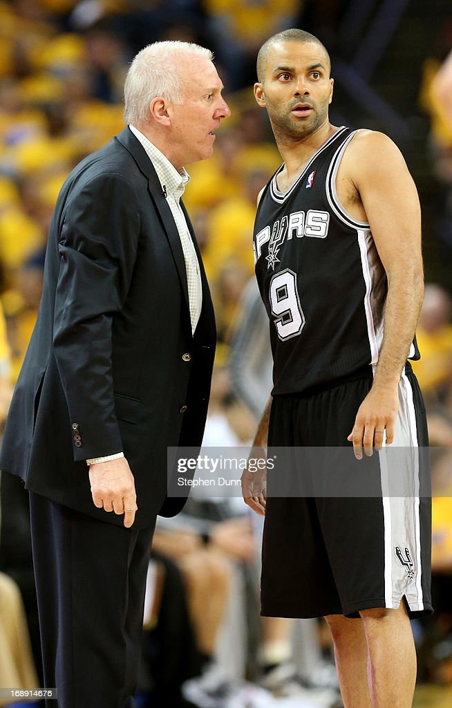 Tony Parker #9 and head coach Gregg Popovich of the San Antonio Spurs confer against the Golden State Warriors in Game Six of the Western Conference Semifinals during the 2013 NBA Playoffs on May 16, 2013 at the Oracle Arena in Oakland, California. The Spurs won 94-82 to take the series 4-2. .