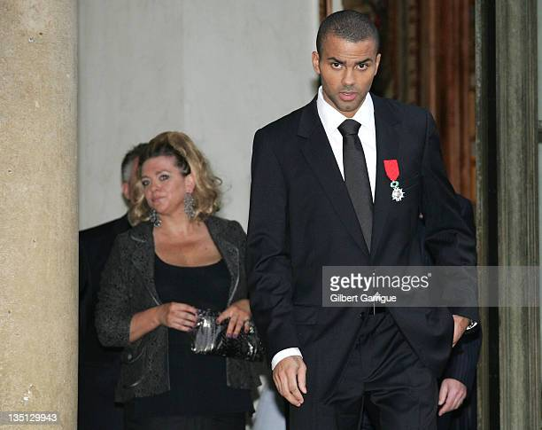 Tony Parker and his mother Pamela Firestone leave the Elysee Palace after he received the Legion of Honor Medal on September 28 2007 in Paris France