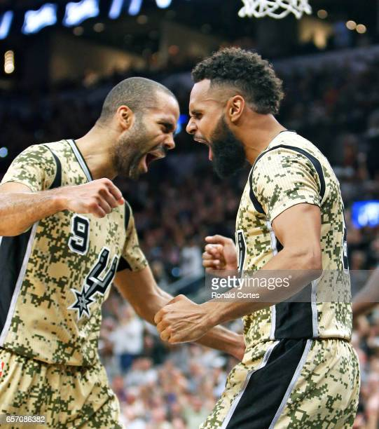 Tony Parker and Patty Mills of the San Antonio Spurs celebrate after a Mills basket against the Memphis Grizzlies at ATT Center on March 23 2017 in...