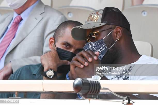 Tony Parker and Teddy Riner attend the French Open 2021 at Roland Garros on June 11, 2021 in Paris, France.