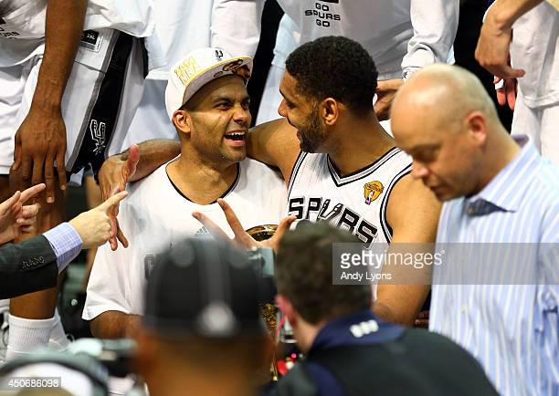Tony Parker and Tim Duncan of the San Antonio Spurs celebrate after defeating the Miami Heat in Game Five of the 2014 NBA Finals at the ATT Center on...