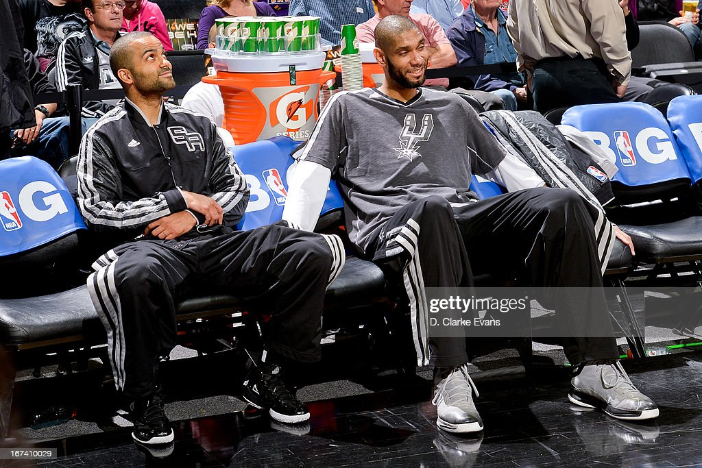 Tony Parker #9 and Tim Duncan #21 of the San Antonio Spurs share a laugh on the bench before playing the Los Angeles Lakers in Game Two of the Western Conference Quarterfinals during the 2013 NBA Playoffs on April 24, 2013 at the AT&T Center in San Antonio, Texas.