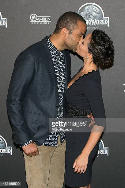 Tony Parker and wife Axelle Francine attend the 'Jurassic World' Premiere at Cinema UGC Normandie on May 29 2015 in Paris France