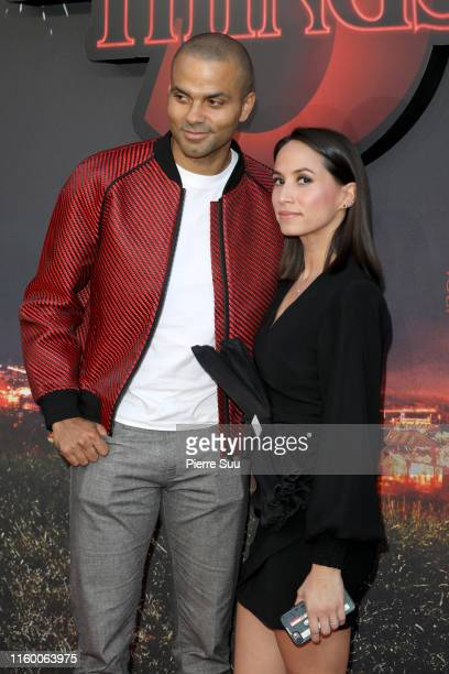 """Tony Parker and wife Axelle Francine attend the Premiere Of Netflix's """"Stranger Things"""" At Le Grand Rex on July 04, 2019 in Paris, France."""