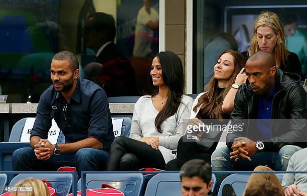 Tony Parker Axelle Francine Andrea Rajacic and Thierry Henry watch Kei Nishikori of Japan plays against Marin Cilic of Croatia prior to their men's...
