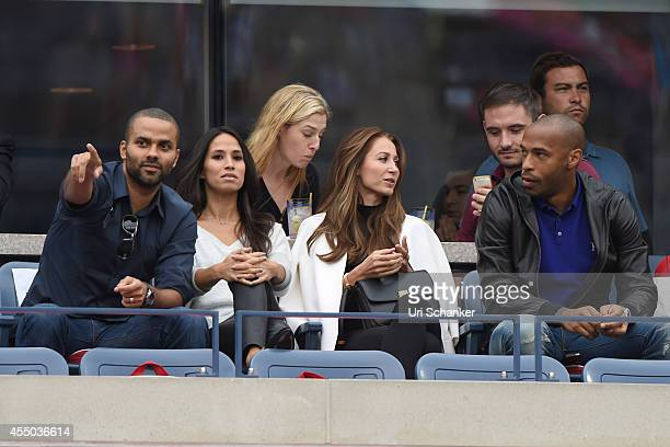 Tony Parker Axelle Parker Thierry Henry and Andrea Rajacic attend day 15 of the 2014 US Open at USTA Billie Jean King National Tennis Center on...