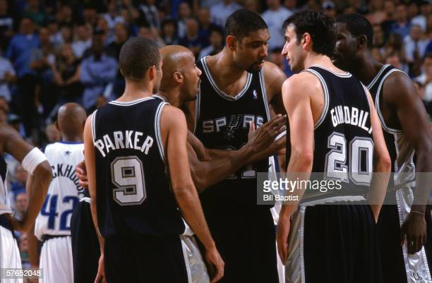Tony Parker Bruce Bowen Tim Duncan Manu Ginobili and Michael Finley of the San Antonio Spurs go over the game plan in a huddle as they take on the...