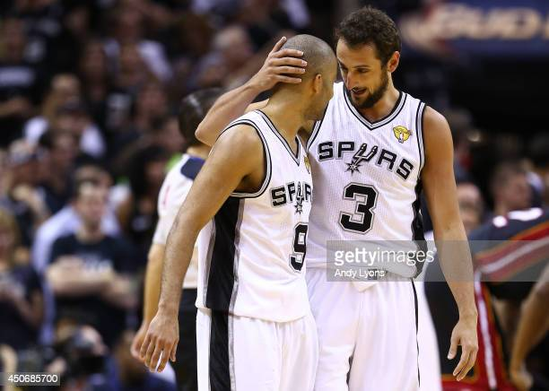 Tony Parker celebrates with Marco Belinelli of the San Antonio Spurs against the Miami Heat during Game Five of the 2014 NBA Finals at the ATT Center...