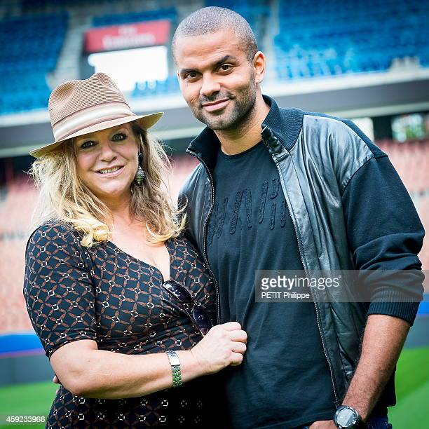 Tony Parker is with his mother Pamela Firestone at the Parc des Prince on September 17 2014 in Paris France