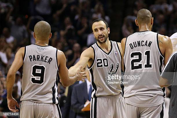 Tony Parker Manu Ginobili and Tim Duncan of the San Antonio Spurs celebrate a play as they walk to the bench during a timeout in overtime against the...