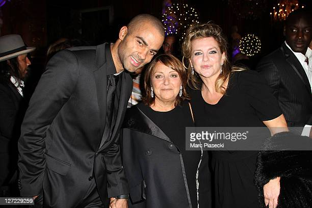 Tony Parker Mrs Darel and Pamela Firestone attend the 'ParCoeur Gala' at Mairie de Paris on September 26 2011 in Paris France