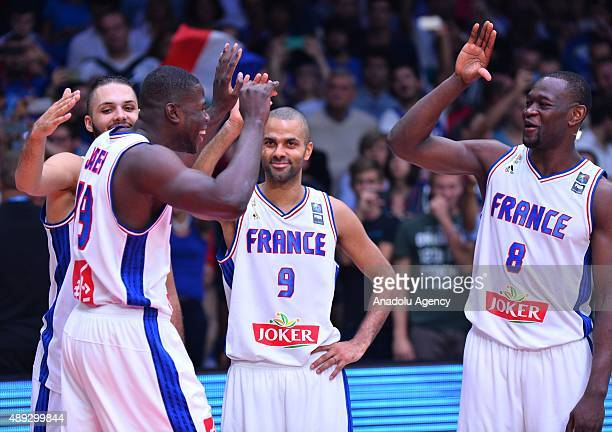 Tony Parker of France celebrates with his team mate Charles Kahudi after winning bronze against Serbia during the EuroBasket 2015 Bronze medal match...