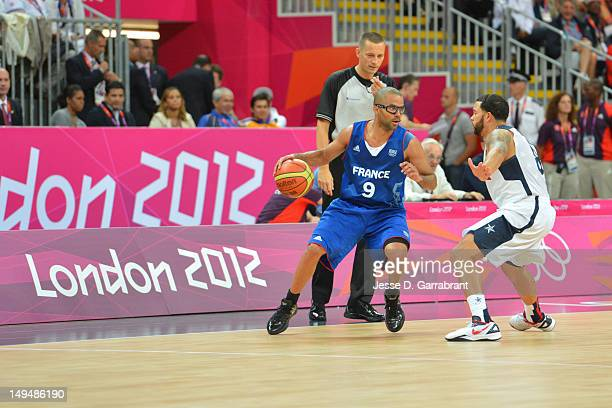 Tony Parker of France drives against Deron Williams of the USA Mens Senior National team at the Olympic Park Basketball Arena during the London...