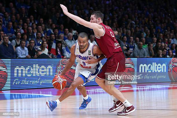 Tony Parker of France drives to the basket against Dairis Bertans of Latvia during the EuroBasket Quarter Final game between France v Latvia at Stade...