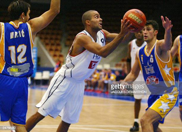 Tony Parker of France goes for a hoop as Bosnia and Herzegovina's Damir Mrsic tries to stop him during their first round match at the Euro 2003...