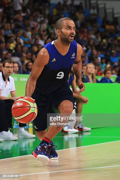 Tony Parker of France handles the ball against Spain during the Men's Quarterfinal match on Day 12 of the Rio 2016 Olympic Games at Carioca Arena 1...