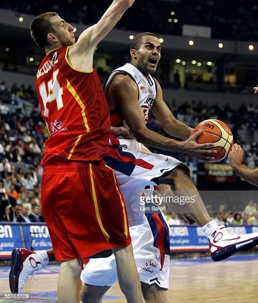 Tony Parker of France in action with Fran Vazquez of Spain during the FIBA EuroBasket 2005 3rd and 4th place playoff match between France and Spain...