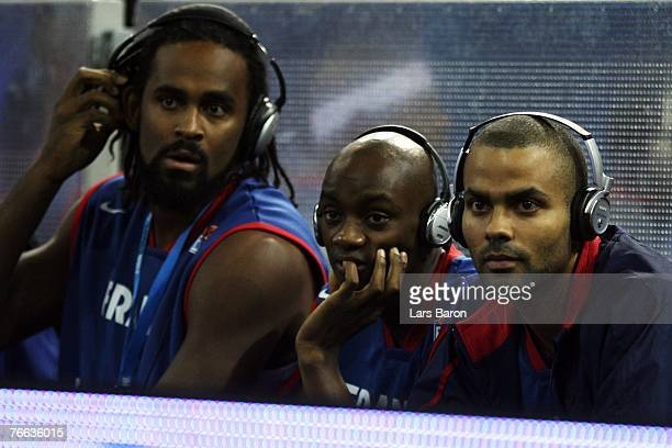 Tony Parker of France looks next to his team mates Ronny Turiaf and Joseph Gomis on prior to the FIBA EuroBasket 2007 qualifying round Group F match...