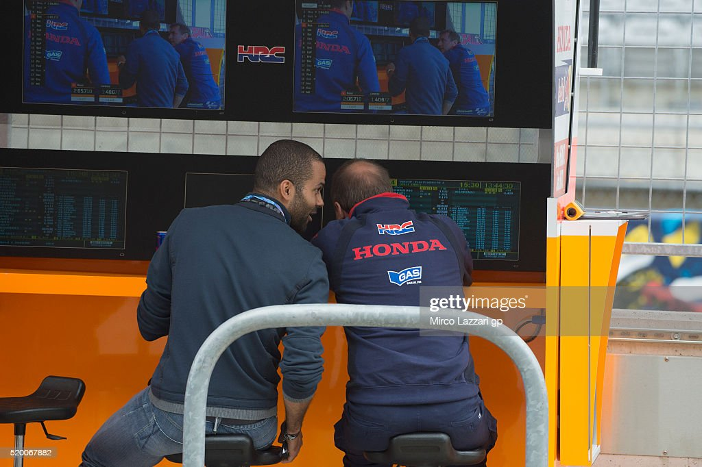 Tony Parker (L) of France (basket player of St. Antonio Spurs) looks on in pit during the MotoGp Red Bull U.S. Grand Prix of The Americas - Qualifying at Circuit of The Americas on April 9, 2016 in Austin, Texas.