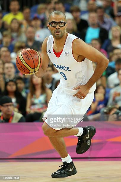 Tony Parker of France moves the ball in the first half while taking on Spain during the Men's Basketball quaterfinal game on Day 12 of the London...