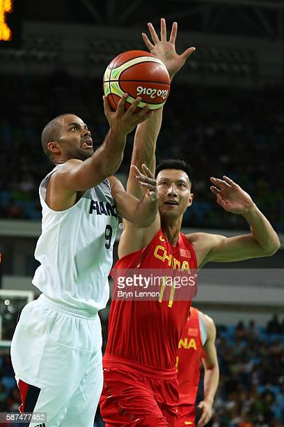 Tony Parker of France shoots the ball over Jianlian Yi of China in the men's preliminary round group A game 19 on Day 3 of the Rio 2016 Olympic Games...