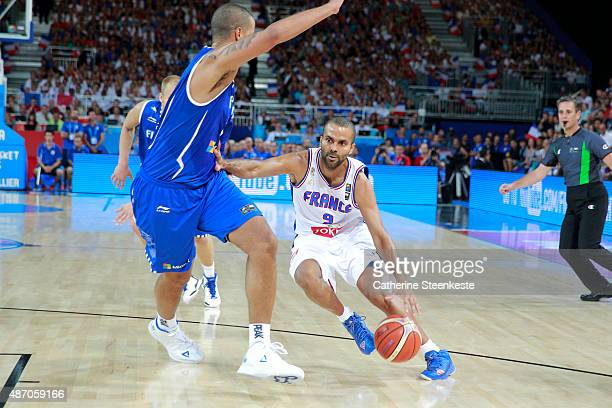 Tony Parker of France tries to drive to the basket against Gerald Lee of Finland during the EuroBasket Group Phase game between France v Finland at...