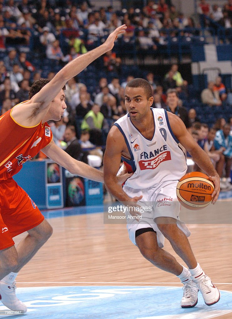 Tony Parker of France tries to escape the clutches of Spanish defender Rudy Fernandez during the Bronze medal match of the European Basketball Championships at the Belgrade Arena, Belgrade, Serbia & Montenegro, 24th September 2005.