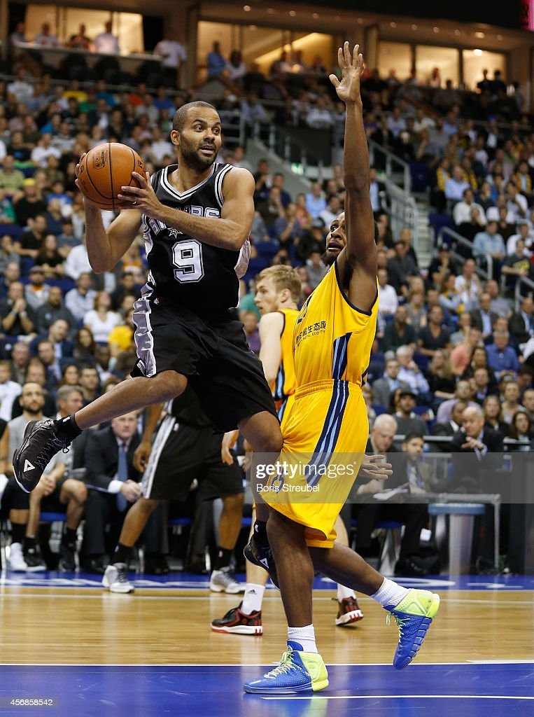 Tony Parker (L) of San Antonio is challenged by Clifford Hammonds of Berlin during the NBA Global Games Tour 2014 match between Alba Berlin and San Antonio Spurs at O2 World on October 8, 2014 in Berlin, Germany.