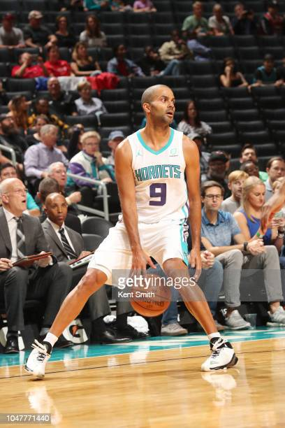 Tony Parker of the Charlotte Hornets handles the ball against the Chicago Bulls during a preseason game on October 8 2018 at Spectrum Center in...