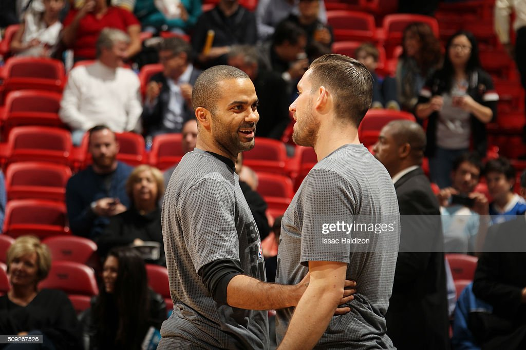 Tony Parker #9 of the San Antonio Spurs and Beno Udrih #19 of the Miami Heat talk before the game on February 9, 2016 at American Airlines Arena in Miami, Florida.