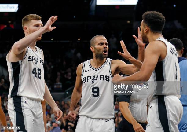 Tony Parker of the San Antonio Spurs and Davis Bertans of the San Antonio Spurs high five Kyle Anderson of the San Antonio Spurs after he scored...