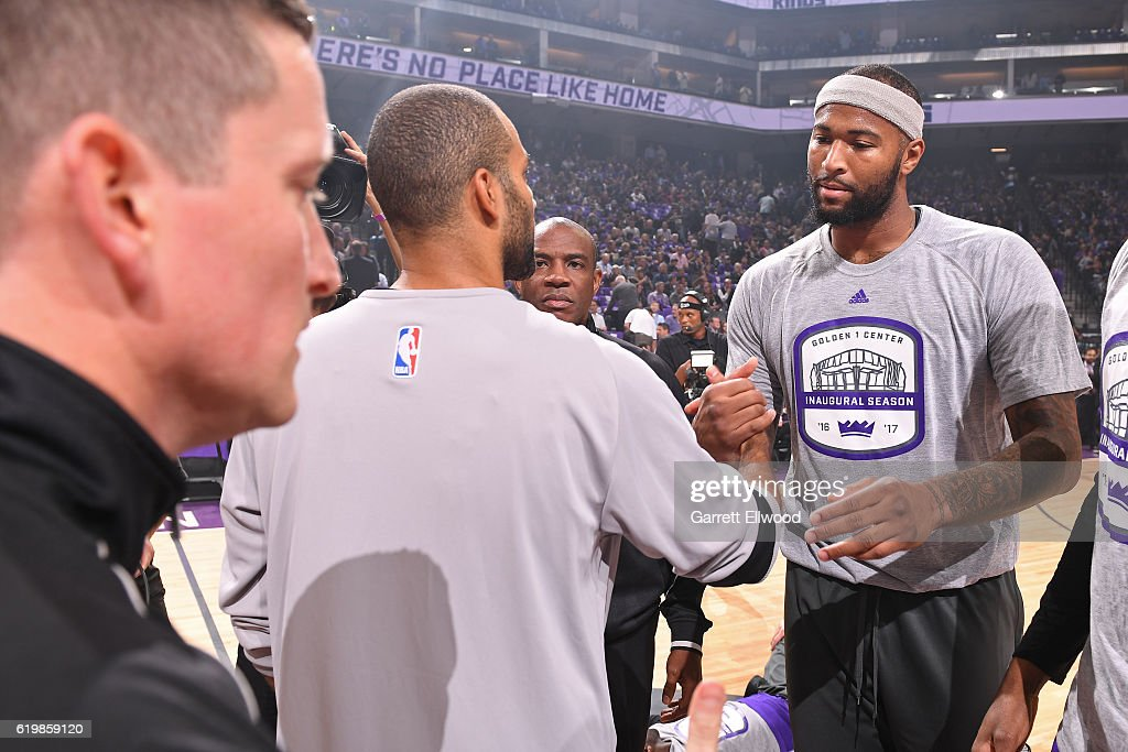 Tony Parker #9 of the San Antonio Spurs and DeMarcus Cousins #15 of the Sacramento Kings shake hands before the game on October 27, 2016 at the Golden 1 Center in Sacramento, California.