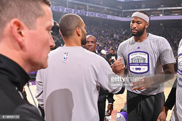 Tony Parker of the San Antonio Spurs and DeMarcus Cousins of the Sacramento Kings shake hands before the game on October 27 2016 at the Golden 1...
