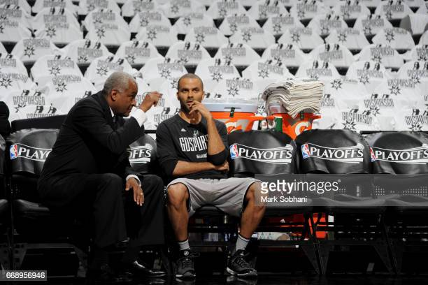 Tony Parker of the San Antonio Spurs and his Father talk before the game against the Memphis Grizzlies in Game One of Round One during the 2017 NBA...