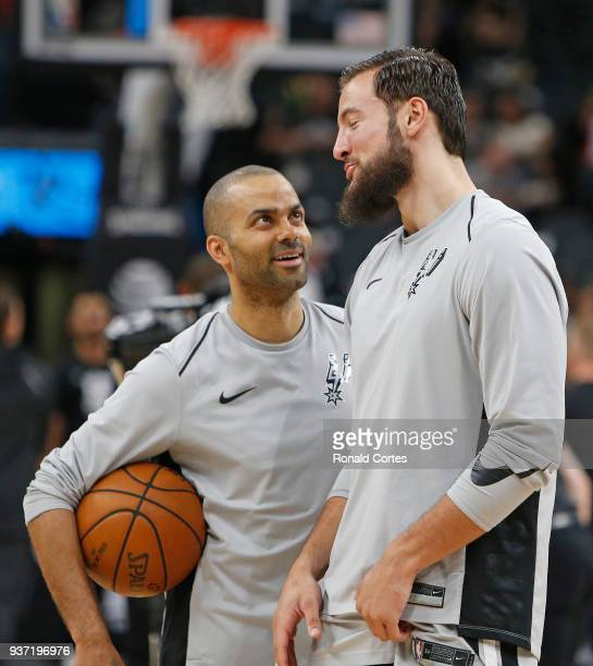 Tony Parker of the San Antonio Spurs and Joffrey Lauvergne of the San Antonio Spurs chat before their game against the Utah Jazz at ATT Center on...