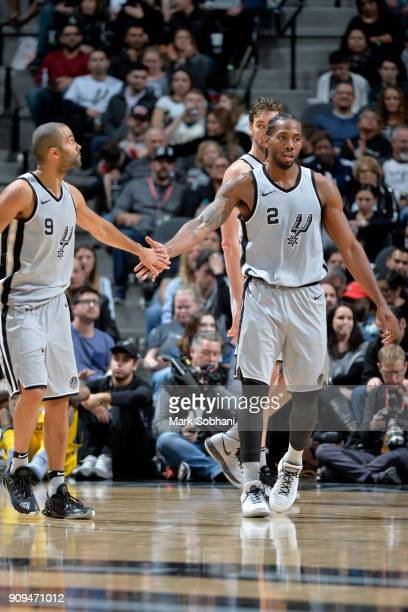 Tony Parker of the San Antonio Spurs and Kawhi Leonard of the San Antonio Spurs high five against the Denver Nuggets on January 13 2018 at the ATT...
