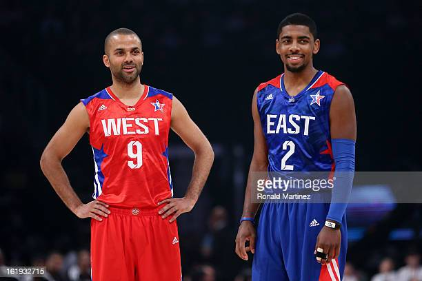Tony Parker of the San Antonio Spurs and the Western Conference stands with Kyrie Irving of the Cleveland Cavaliers and the Eastern Conference in the...