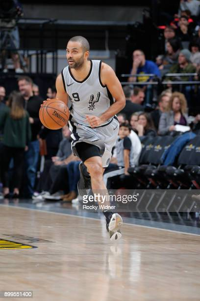 Tony Parker of the San Antonio Spurs brings the ball up the court against the Sacramento Kings on December 23 2017 at Golden 1 Center in Sacramento...
