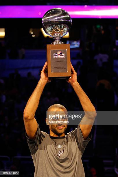Tony Parker of the San Antonio Spurs celebrates with the trophy after he won the Taco Bell Skills Challenge part of 2012 NBA AllStar Weekend at Amway...