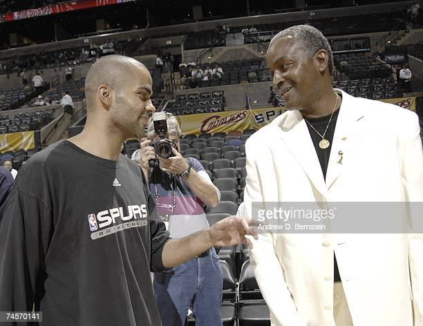Tony Parker of the San Antonio Spurs chats with his dad Tony Parker Sr prior to Game One of the 2007 NBA Finals at The ATT Center on June 7 2007 in...