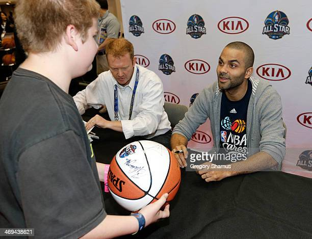 Tony Parker of the San Antonio Spurs does a autograph session at the KIA MVP court during the 2014 NBA AllStar Jam Session at the Ernest N Morial...