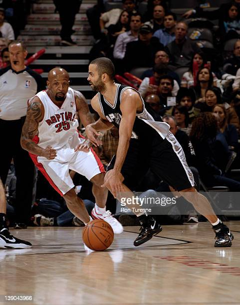 Tony Parker of the San Antonio Spurs dribbles against Anthony Carter of the Toronto Raptors on February 15 2012 at the Air Canada Centre in Toronto...
