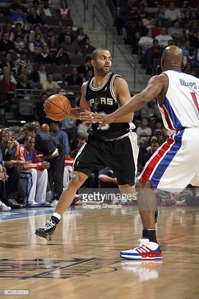 Tony Parker of the San Antonio Spurs dribbles the ball against Chauncey Billups of the Detroit Pistons during the NBA game on March 14 2008 at the...