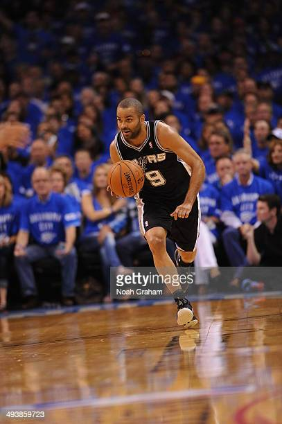 Tony Parker of the San Antonio Spurs dribbles the ball against the Oklahoma City Thunder in Game Three of the Western Conference Finals during the...
