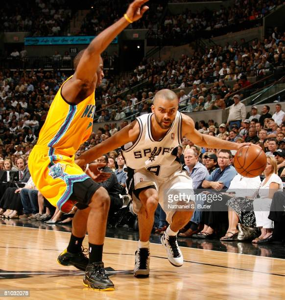 Tony Parker of the San Antonio Spurs drives against Chris Paul of the New Orleans Hornets in Game Three of the Western Conference Semifinals during...