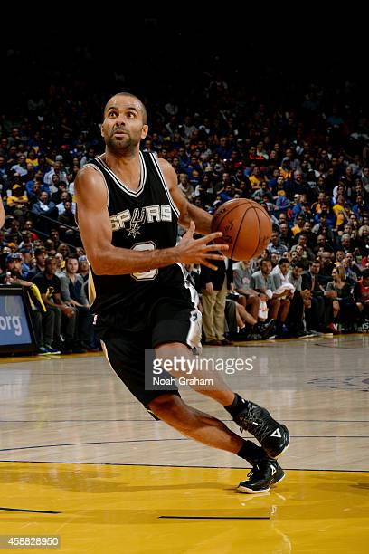 Tony Parker of the San Antonio Spurs drives against the Golden State Warriors on November 11 2014 at Oracle Arena in Oakland California NOTE TO USER...