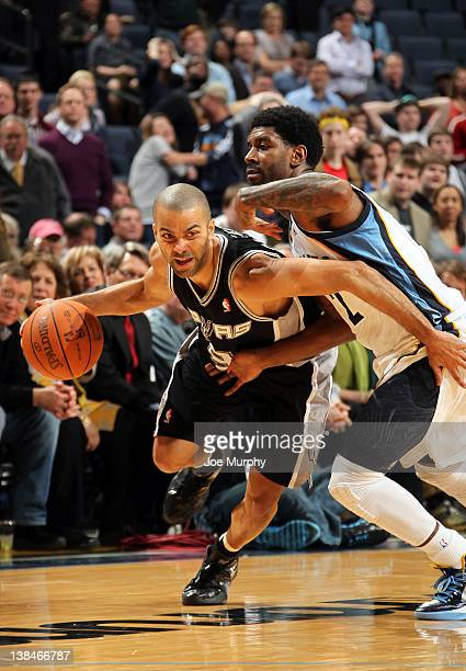 Tony Parker of the San Antonio Spurs drives around OJ Mayo of the Memphis Grizzlies on February 6 2012 at FedExForum in Memphis Tennessee NOTE TO...