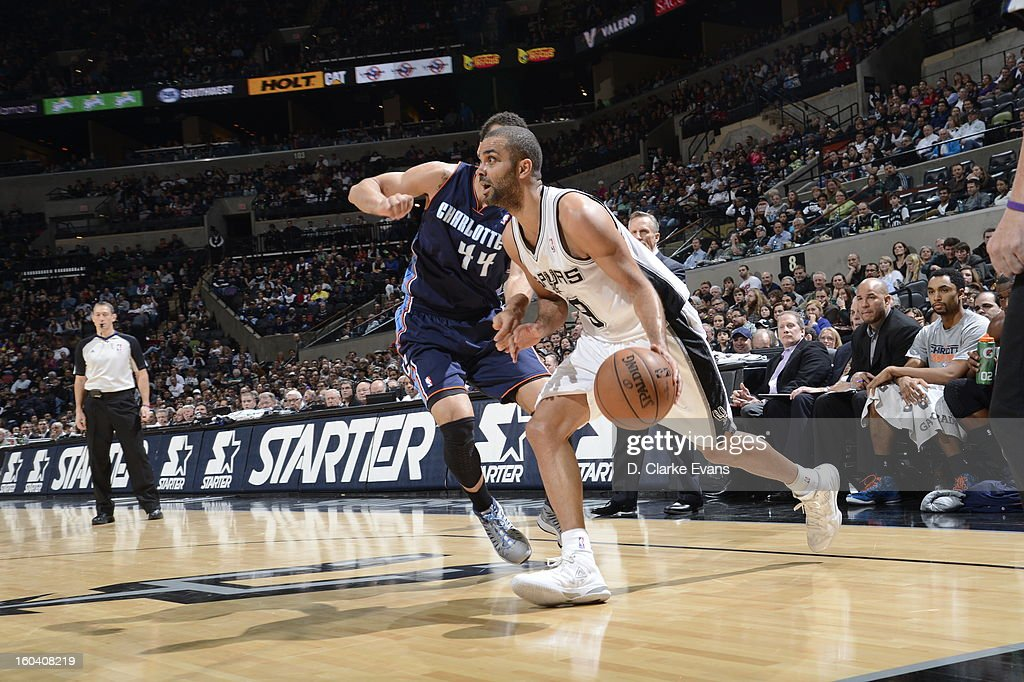 Tony Parker #9 of the San Antonio Spurs drives baseline against Jeffery Taylor #44 of the Charlotte Bobcats on January 30, 2013 at the AT&T Center in San Antonio, Texas.